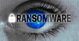 The word ransomware over a piercing blue eye