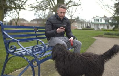 Man on bench with dog